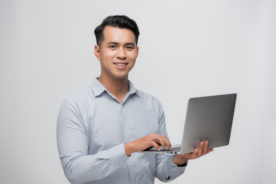 Happy smile Asian man using laptop with positive feeling on white. business success concept.
