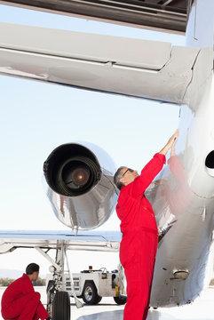 Aeronautical engineers inspecting airplane