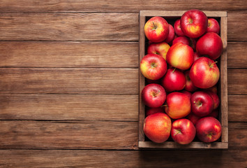 Wall Mural - red apples in box on wooden table