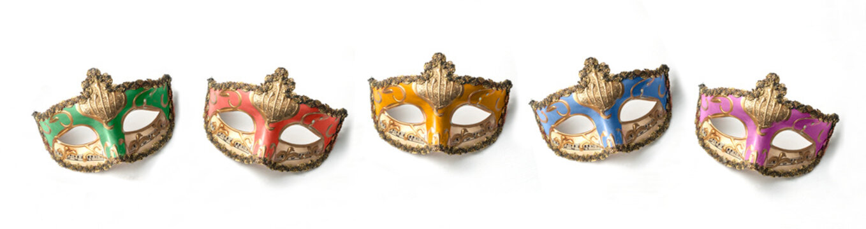 Five theater or mardi gras venetian masks on white background