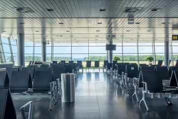 Modern airport waiting hall interior with empty chairs. Fotomurales