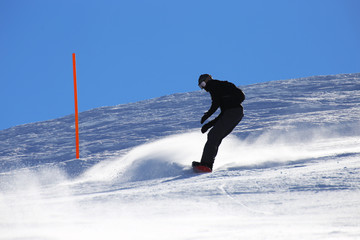 Snowboarder riding the slope
