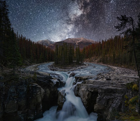 Sunwapta Falls with Milky way in autumn at Icefields Parkway, Jasper national park