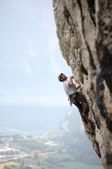 a sport climbing man on a rock wall