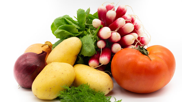 Radish, dill, red tomato, potatoes, red onion yellow onion on a white background. Isolated