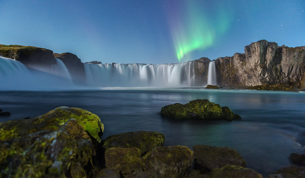 Northern Light at Godafoss waterfall in Iceland