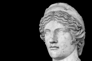 Head of young female roman statue - black and white photo with closeup