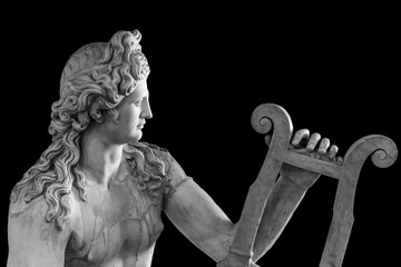 Ancient roman statue of God Apollo playing a lire - black and white photo
