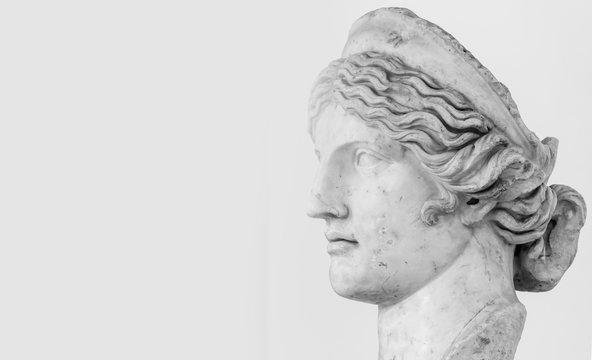 Profile of female young roman statue - black and white photo with closeup