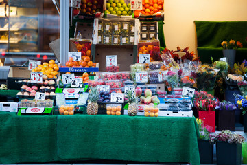 Fruits and flowers for sale at store