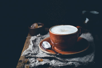 Coffee cup cappuccino with cinnamon, vintage style effect picture