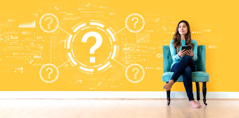 Question marks with young woman holding a tablet computer Wall mural