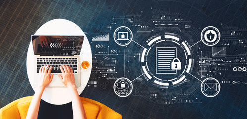 Wall Mural - Data protection concept with person using a laptop on a white table