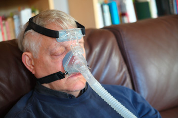 Man rests with CPAP device