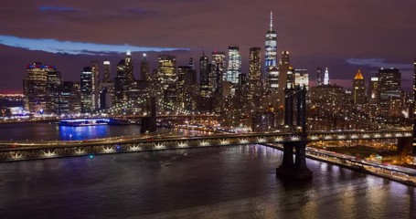 Fototapete - New York City downtown buildings skyline aerial hyperlapse night