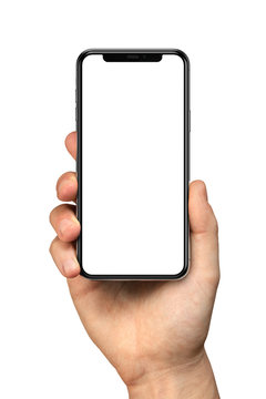 Man hand holding the black smartphone with blank screen and modern frameless design - isolated on white background