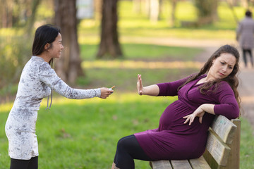 Pregnant woman rejecting the cigarette