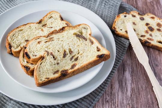 fruit bread (Dutch Krentenbrood) with raisins on white plate