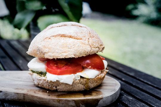 sandwich caprese, bun with mozzarella and tomato