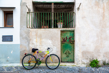 Procida (Italy) - Colored walls and bike in Procida, a little island in Campania, southern Italy