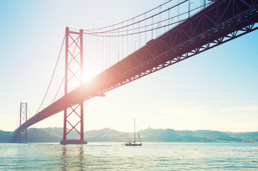 25th April Bridge in Lisbon, Portugal. Summer landscape. At this point the Tejo river flows into the Atlantic ocean Wall mural