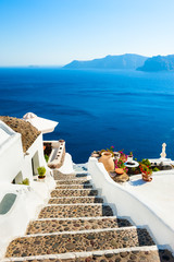 Spoed Foto op Canvas Santorini White architecture and blue sea on Santorini island, Greece. Stairs to the sea. Summer holidays, travel destinations concept