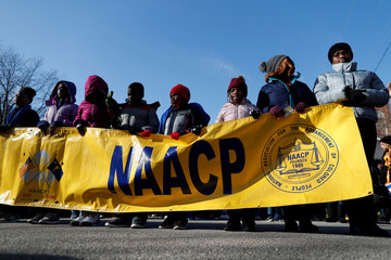 Children hold a NAACP banner during the Martin Luther King Jr. (MLK) Day Parade in Columbia