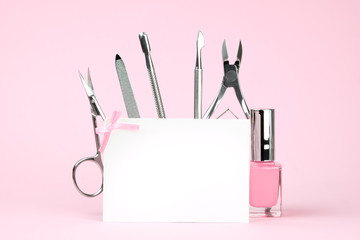 Foto op Plexiglas Manicure Manicure tools on a pink background, white card with place for text, template for advertising of beauty salons. Beauty and body care concept.