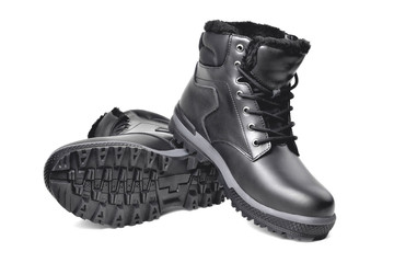 Winter men's black leather boots on a white background, hiking shoes, practical off-road shoes, close-up