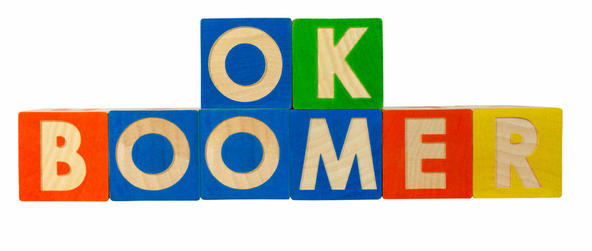 OK BOOMER spelled out with colorful toy block. OK BOOMER is a catchphrase used to dismiss or mock attitudes stereotypically attributed to the baby boomer generation.
