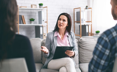 Therapist talking with married patients at private consultation