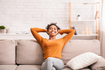 Poster de jardin Detente Happy Black Woman Relaxing Sitting On Sofa At Home