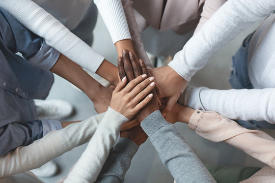 Business team putting hands together on top of each other