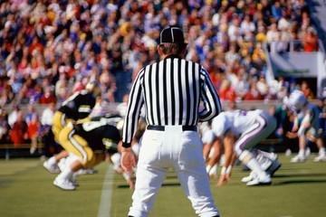 Referee watching football game