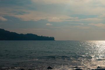 Beautiful scenery of sun rays shining in the ocean  Haad Laem Sing, Kamala, Kathu District