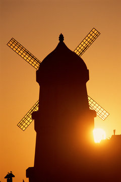 Classic windmill against sunset