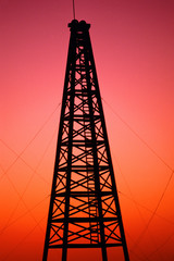 Oil drilling rig at sunset