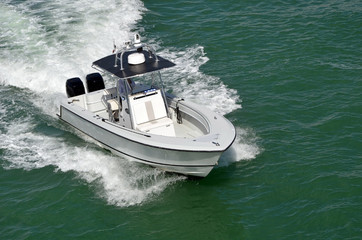 White motor boat powered by two outboard engines speeding on the Florida Intra-Coastal Waterway off Miami Beach Wall mural