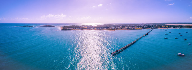 Fotobehang Purper Wide aerial panorama of Beachport jetty and moored boats in South Australia at sunset