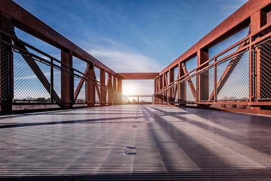 Beautiful scenery of sun rays shining through a bridge in Winston Salem, North Carolina