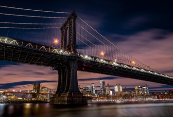 Beautiful cityscape with a suspension bridge and buildings in Main Street Park New York, USA