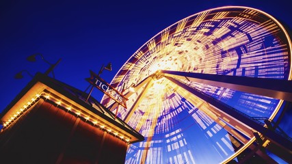 Low angle shot of a Ferris wheel on Chicago Navy Pier during the evening time