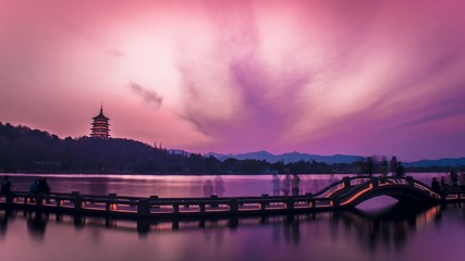 Wall Murals Candy pink Breathtaking sunset over the historic West Lake, Hangzhou, China