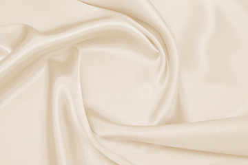 Draped satin beige fabric for festive backgrounds