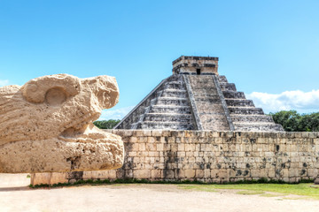 Ancient Serpent Scultpure With Pyramid of Kukulcan at Chichen Itza