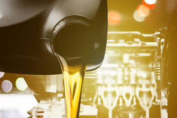 Pouring oil motor car  lubricant  from black bottle on engine background , service oil change auto repair shop Wall mural