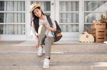 young traveler wearing shoe infront of house before go travel Wall mural