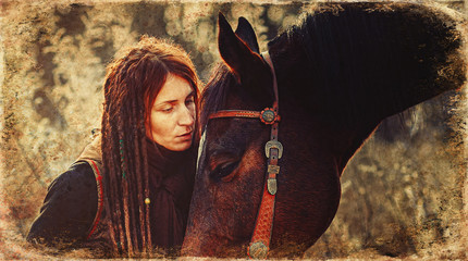 Young beautiful dreadded girl outdoors with her true horse. Old photo effect.