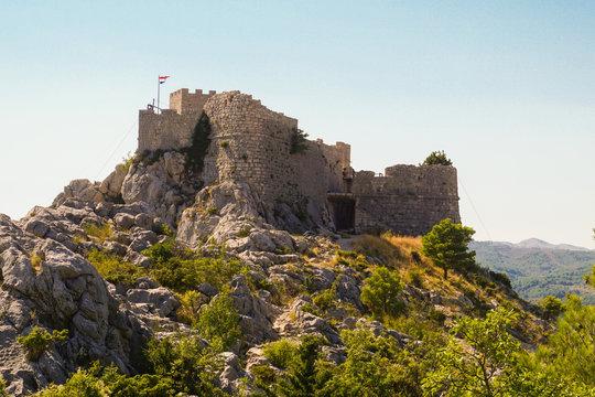 The ruins of the medieval pirate fortress Stari Grad in Omis, Croatia