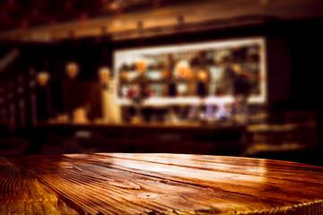 Spoed Foto op Canvas Muziekwinkel Desk of free space and blurred background of bar